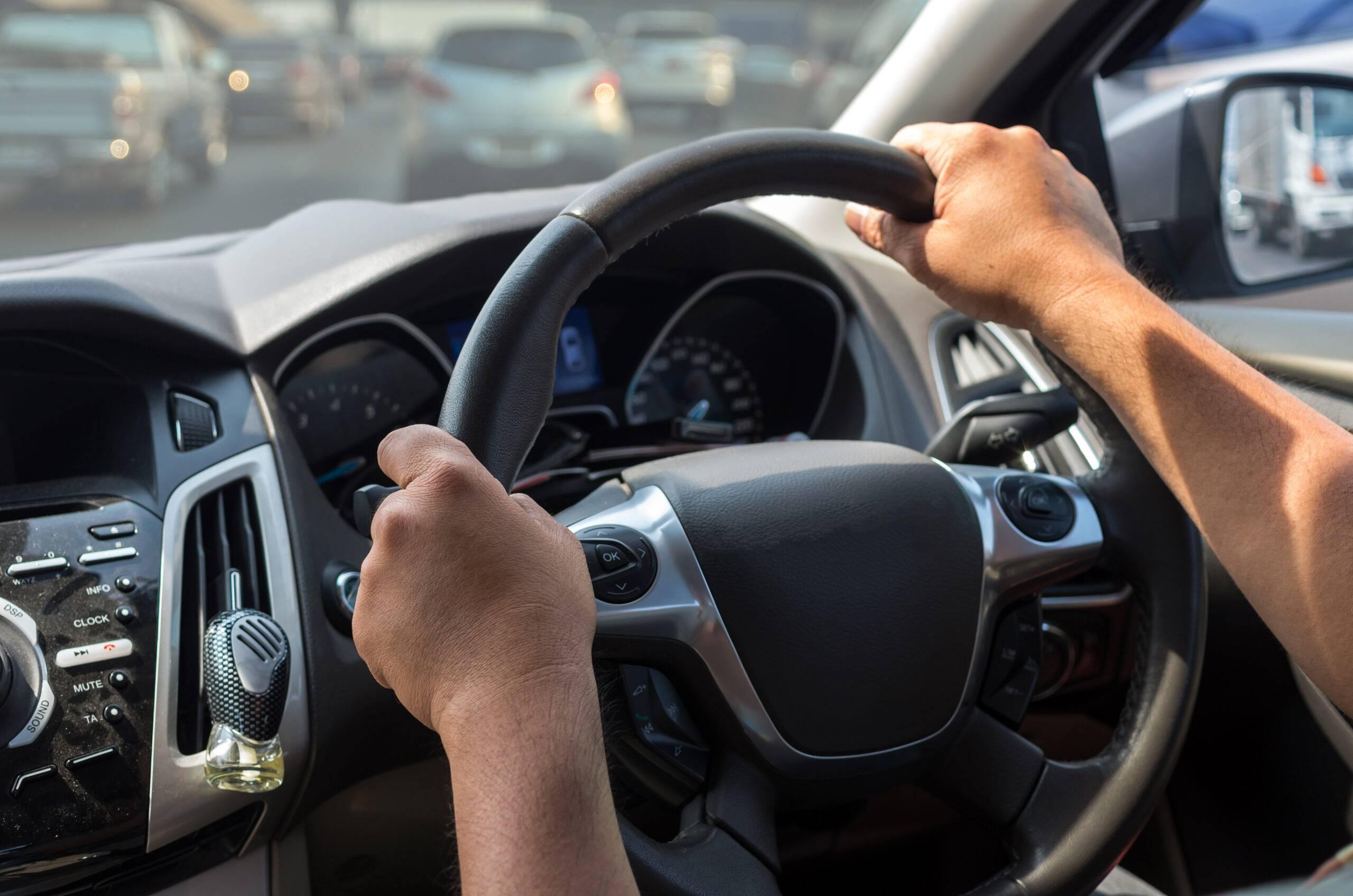 Closeup Hand driving a car